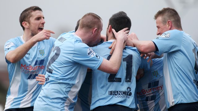 Ballymena United players celebrate victory over Warrenpoint Town