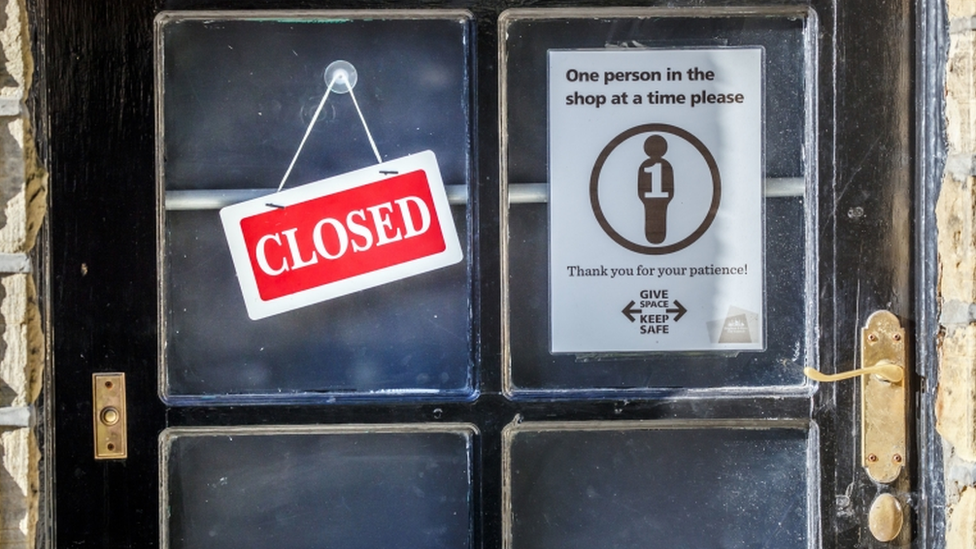 Signs on a shop in West Yorkshire