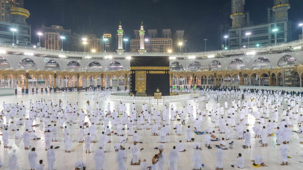 Muslims keep a safe social distance while performing Umrah at the Grand Mosque on 1 November 2020