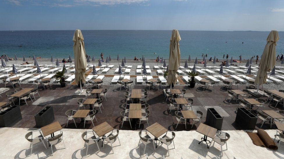 Tables and deckchairs are set out to respect social distancing on the Promenade des Anglais in Nice