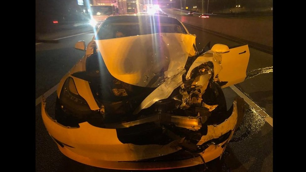 A Tesla Model 3 photographed from the front following a crash.
