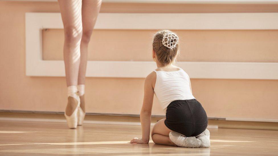 Child watching adult en pointe