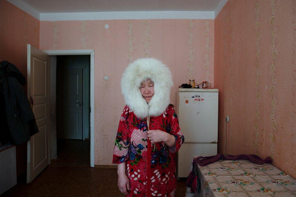 Pudani Audi (born.1948) in her apartment. Yar-Sale village, Yamal Peninsula, Siberia, Russia.