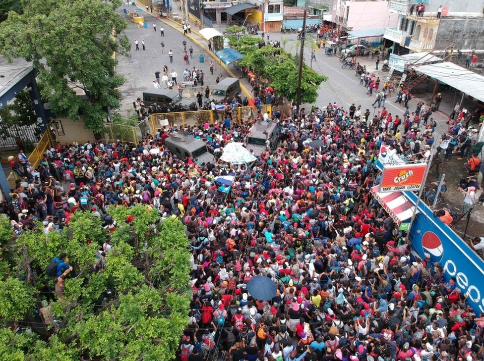An aerial view of the migrant group reaching the Guatemala-Mexico international bridge in Tecun Uman, Guatemala