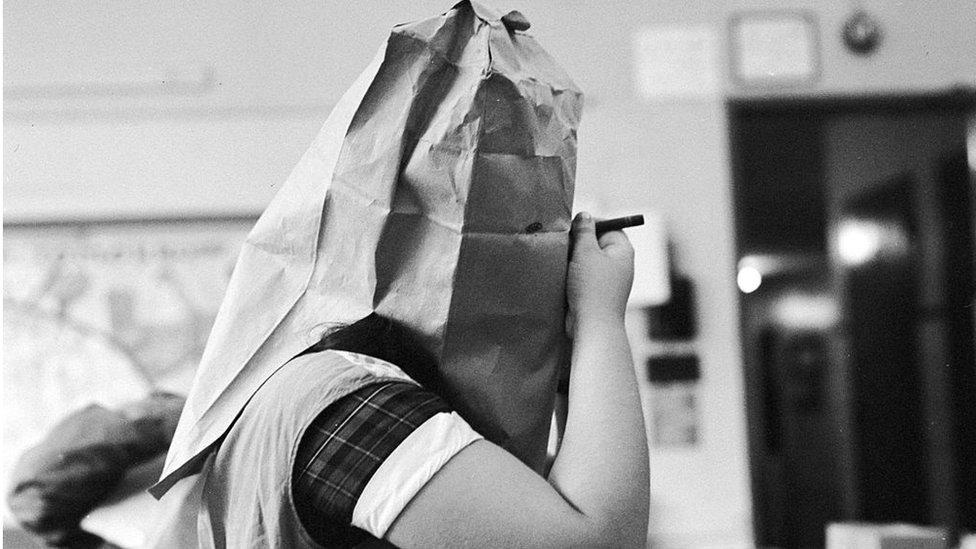 Girl making Halloween mask