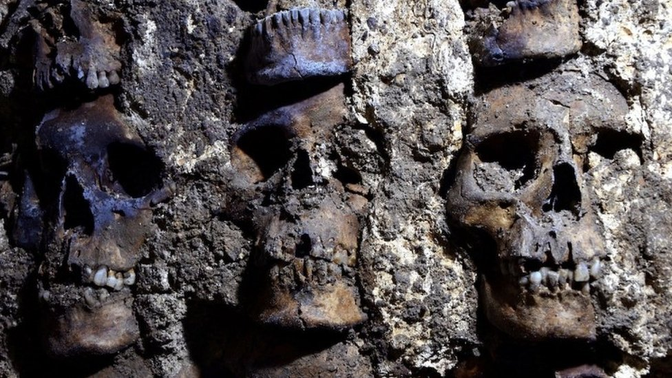 A photo shows parts of an Aztec tower of human skulls, believed to form part of the Huey Tzompantli