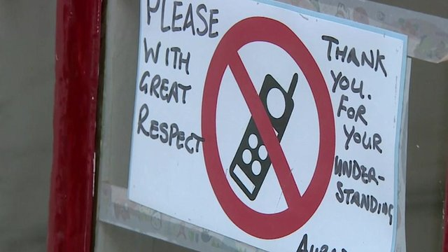 Sign telling diners of mobile phone ban
