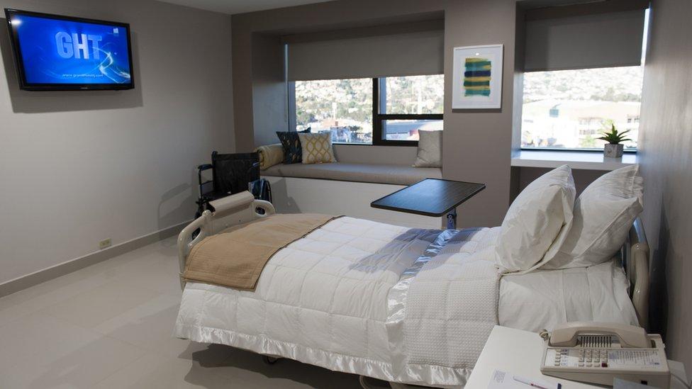 Una habitación de Grand Care