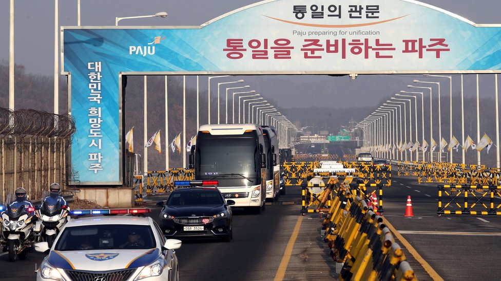 A coach carrying the North Korean delegation arrives at Grand Unification Bridge, near the DMZ, in Paju, South Korea on 21 January 2018