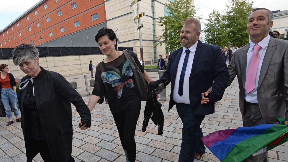 The two couples leaving court in Belfast