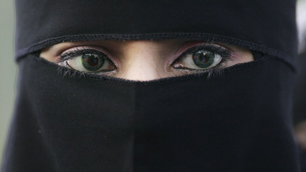 A woman wearing a niqab veil