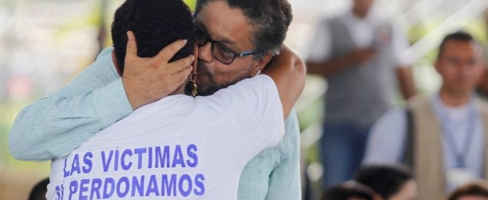 Farc commander Ivan Marquez hugs a victim of the Chinita massacre, as members of FARC publicly apologize at the San Pedro Claver High school in Apartado, Colombia, September 30, 2016.
