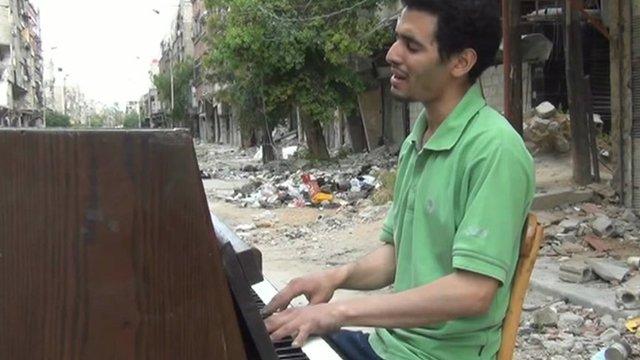 Ayham playing piano