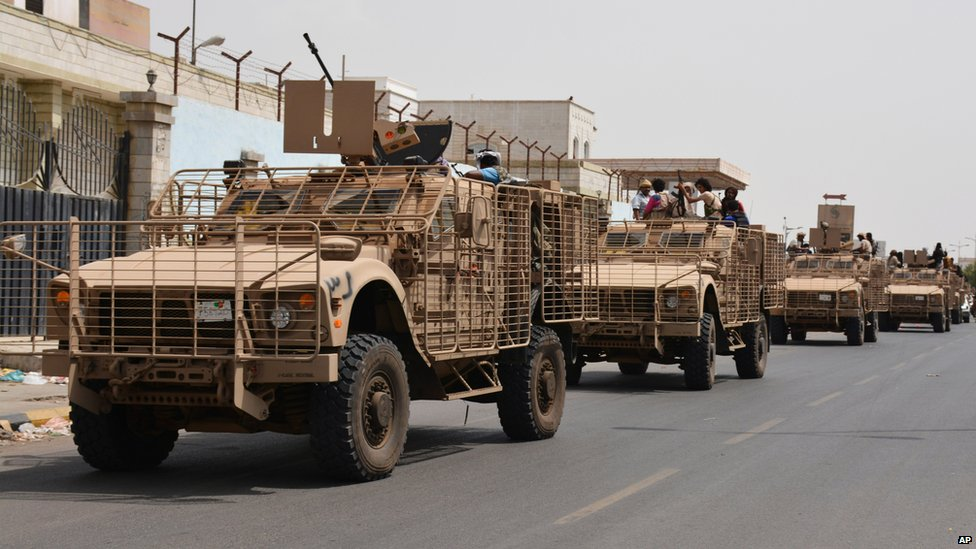 Pro-government fighters are transported in armoured vehicles through the streets of Yemen's second city of Aden (14 July 2015)