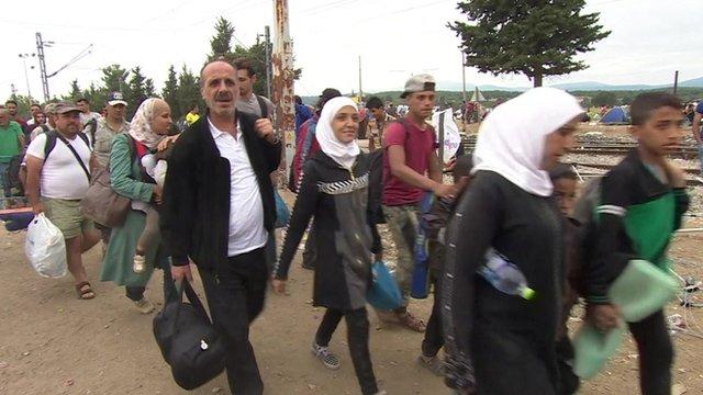Migrants queue to enter Macedonia