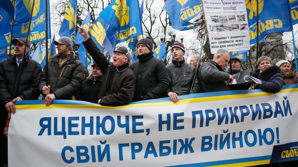 Ukrainian supporters of nationalist Svoboda (freedom) party in protest demanding Yatsenyuk to step down