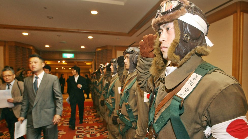 """Men dressed in kamikaze uniform as the then Tokyo Governor held a news conference to promote his movie """"For Those We Love"""" in 2006"""