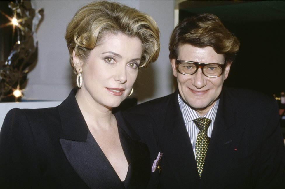 Yves Saint Laurent and Catherine Deneuve pictured at the opening of his beauty institute, in Paris