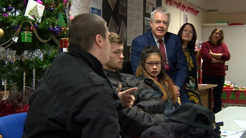 Carwyn Jones talks to young homeless people at the offices of Llamau in Cardiff