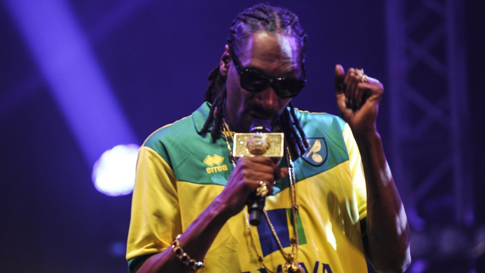 Snoop Dogg performing on stage