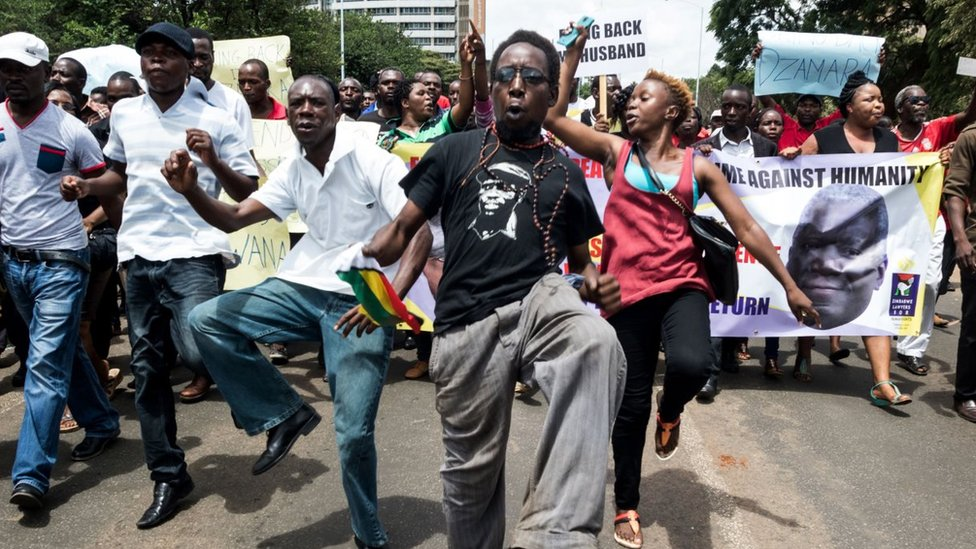 Demonstrators sing, dance and shout political slogans during a march to mark the one year anniversary of the disappearance of Itai Dzamara on March 9, 2016 in Harare. Dzamara a former journalist before he turned political activist was the leader of a group called Occupy Africa Unity Square park which sought to pressure Mugabe to step down for presiding over the collapse of the economy.