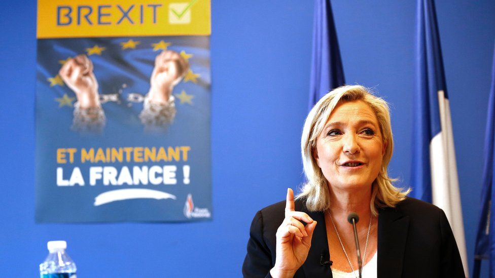 """FN leader Marine Le Pen with Brexit poster saying """"And now France!"""", 24 Jun 16"""