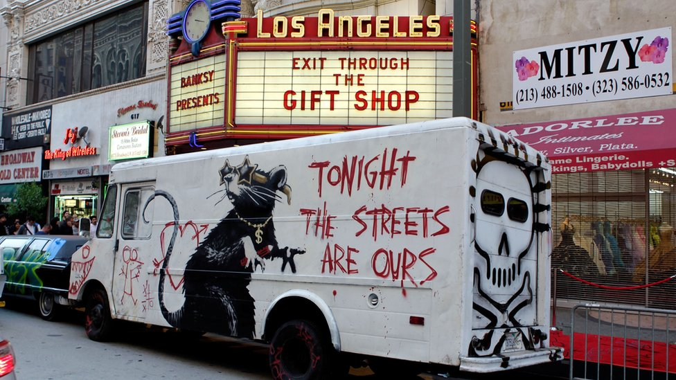 Large rat mural advertising Banksy's Exit Through the Gift Shop exhibition in Los Angeles