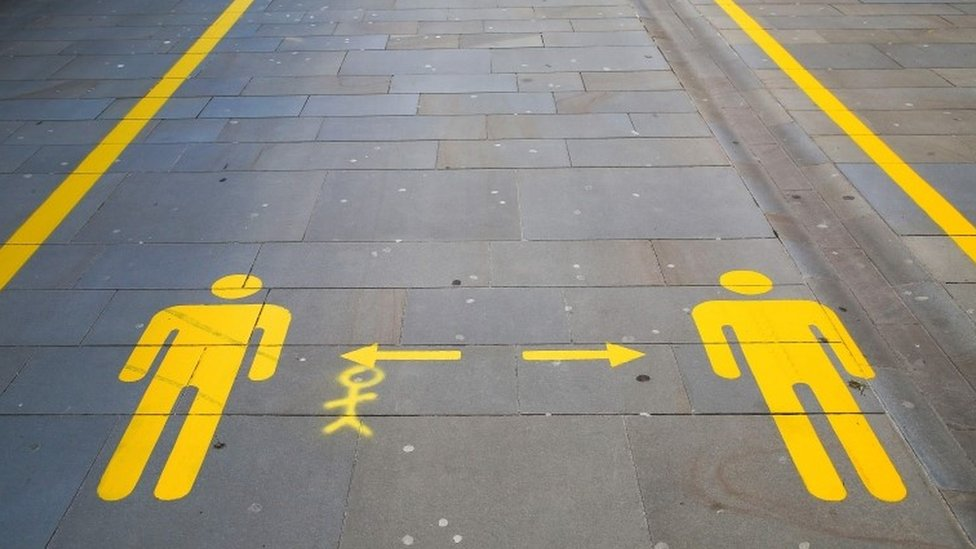 A pavement marking the way in Cardiff city centre