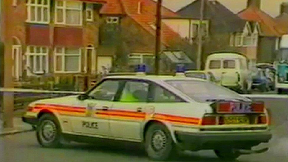A police car at the scene of Gérard Hoarau's murder in Edgware in London