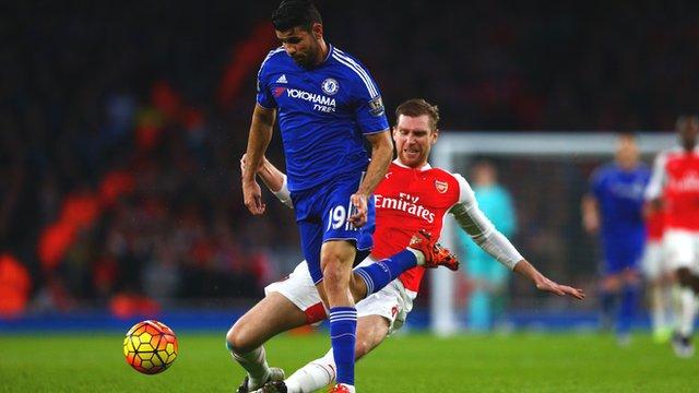 Arsenal's Per Mertesacker tackles Chelsea's Diego Costa
