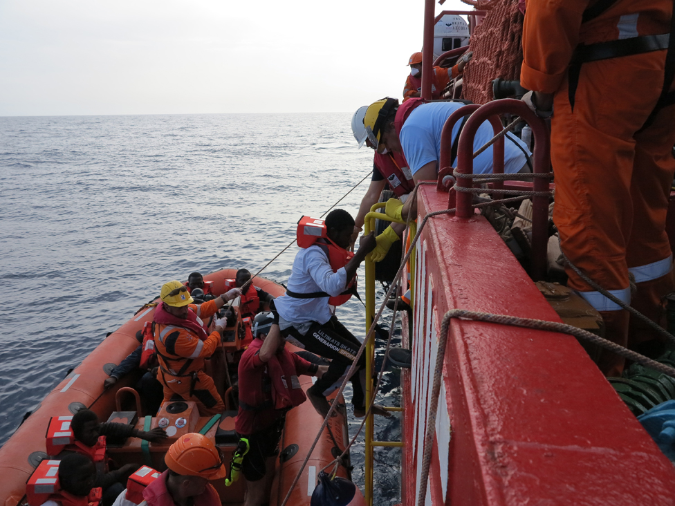 Man scrambles aboard rescue ship