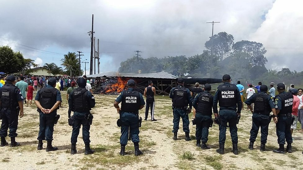 Police try to maintain control as Brazilian residents demonstrate against the presence of Venezuelan immigrants in Pacaraima, Brazil, 18 August 2018