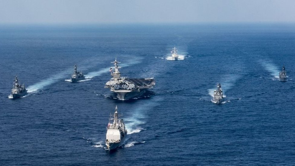 The Carl Vinson being escorted by other warships