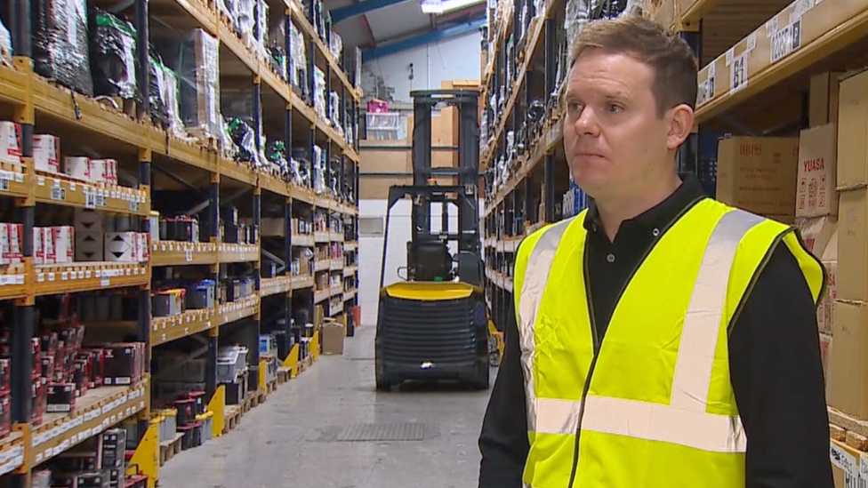 Sam Taylor in Tayna Batteries' warehouse