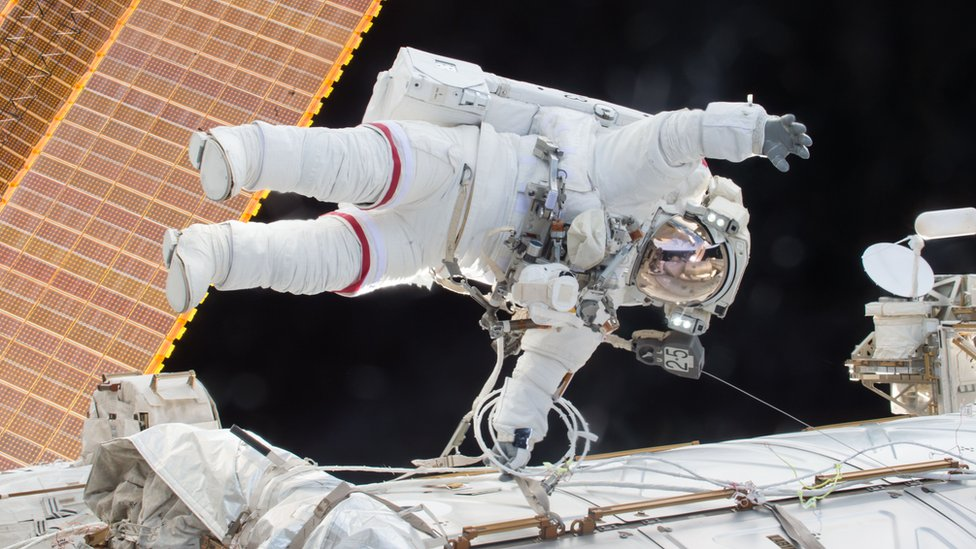 Handout photograph shows Scott Kelly floating outside of space station