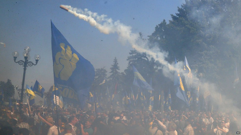 A smoke bomb is thrown outside parliament in Kiev