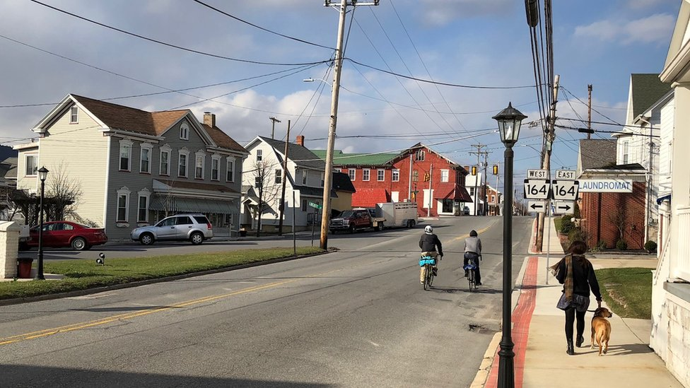 Martinsburg - person and dog walking down street