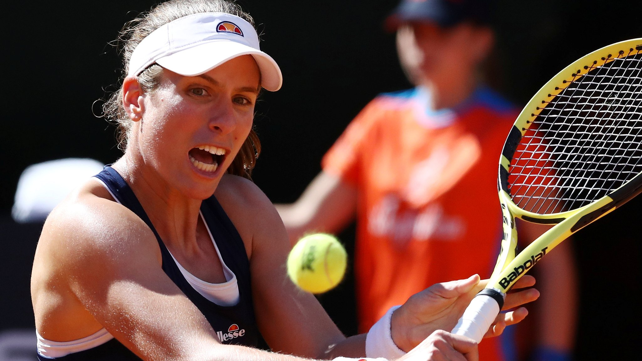 Konta wins twice in day to reach quarter-finals