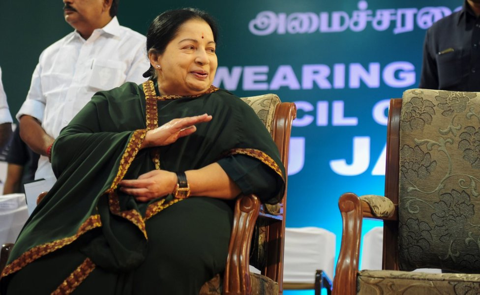 Jayaram Jayalalitha, leader of the Anna Dravida Munnetra Kazhagam (AIADMK) state political party, gestures during a campaign rally in Chennai on April 9, 2016.