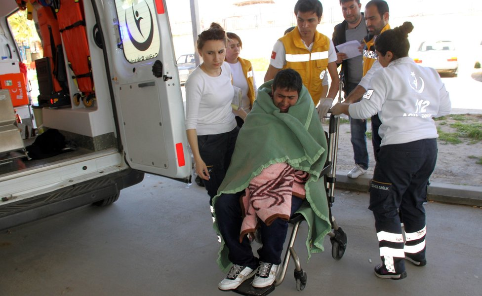 Medics take care of a rescued migrant at a local hospital in the Aegean resort of Didim, Turkey, Sunday, March 6, 2016