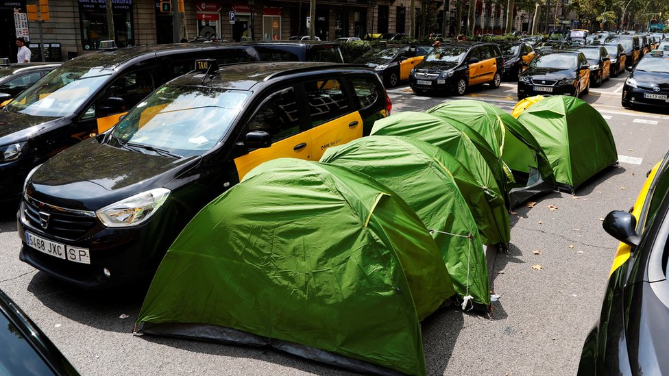 6 Hundreds of parked taxi vehicles occupy the Gran Via avenue in downtown Barcelona, north-eastern Spain, 29 July 2018, during their fifth day of strike