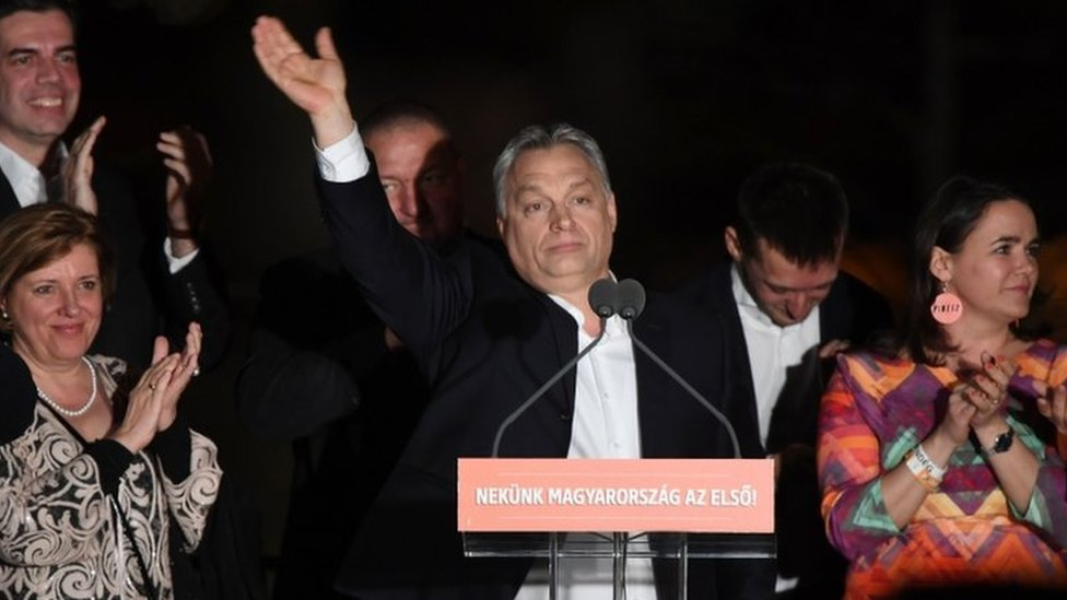 Hungarian Prime Minister Viktor Orban (C) and members of his FIDESZ party celebrate winning the election