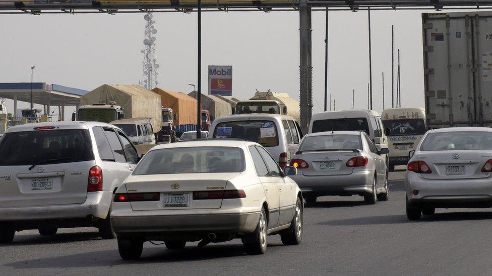 Motorists drive past a MTN billboard across Lagos-Ibadan expressway on November 15, 2015.