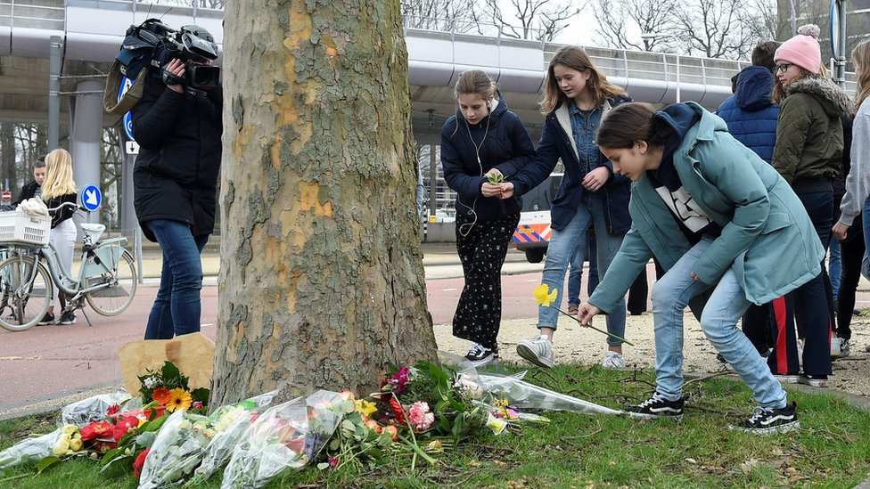 Teenagers were among many laying flowers at the scene of Monday's shooting in Utrecht on Tuesday