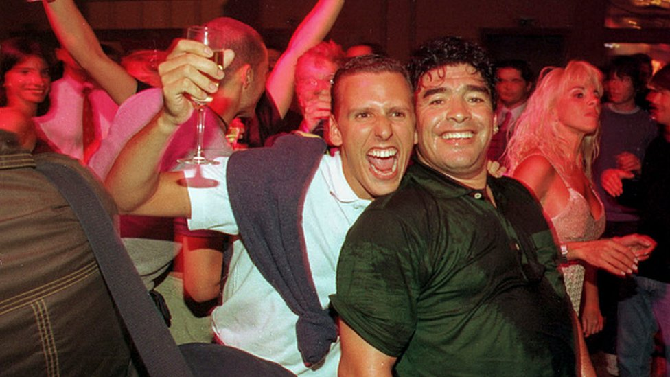 A fan smiles and hugs Diego Maradona during a party at the Conrad Hotel in 1999 in Punta del Este, Uruguay