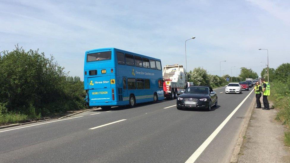Twenty hurt in school bus lorry crash on Dunstable road