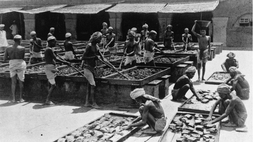 Indian workers making opium