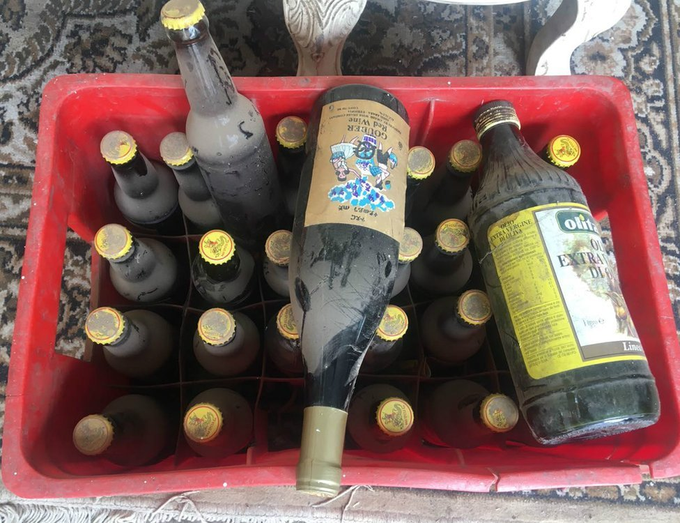 Bottles of beer, wine and olive oil in a crate
