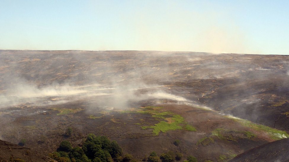 Smoke hanging over Saddleworth Moor