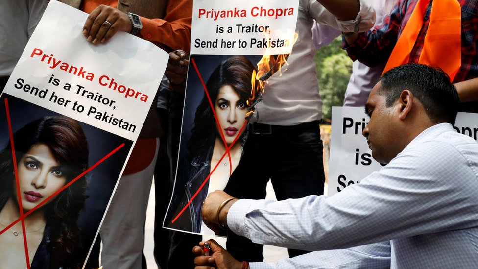 Supporters of Hindu Sena, a right wing Hindu group, shout slogans and burn posters of Bollywood actress Priyanka Chopra during a protest in June 9 2018